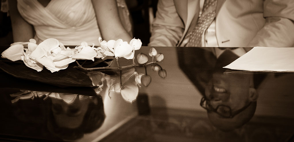 Reflection on table of wedding couple in italy